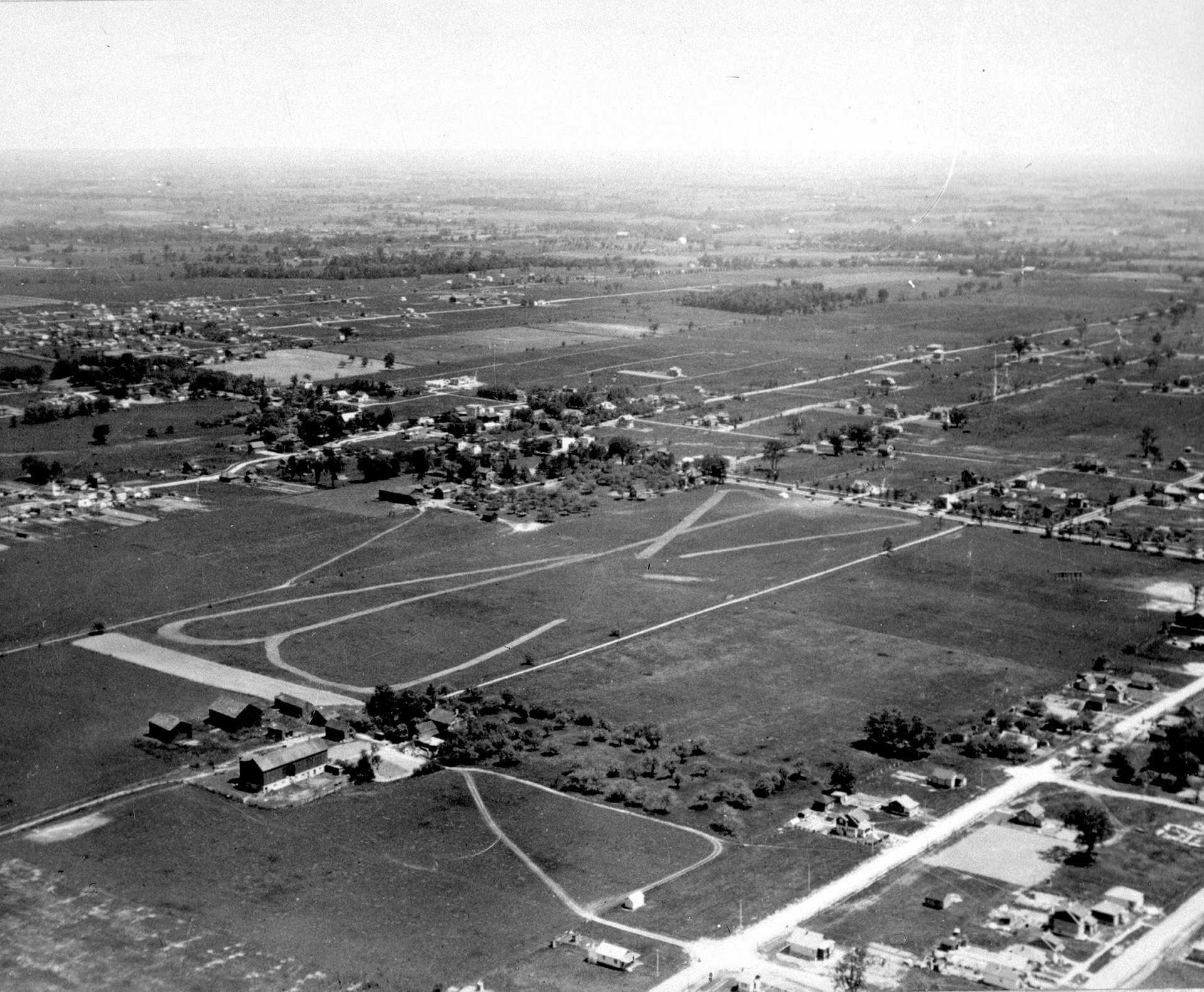 Aerial view of land east and west of Yonge Street between Burndale Avenue and north of Finch Avenue, North York, 1927 (photo: Toronto Public Library NYHS00373, gift of North York Historical Society)